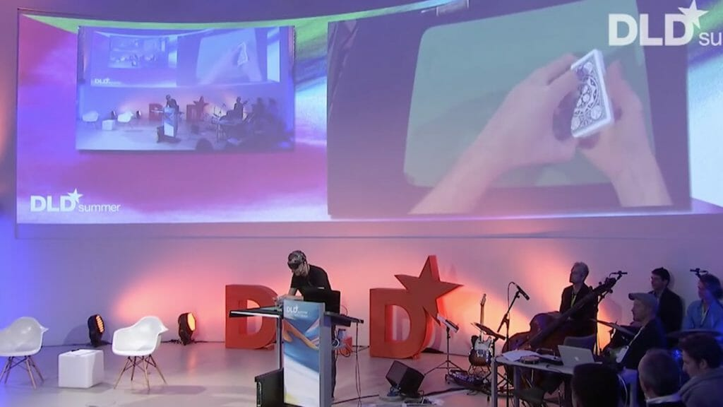 MIT Media Lab fellow Marco Tempest performs magic onstage at DLD Summer 2015